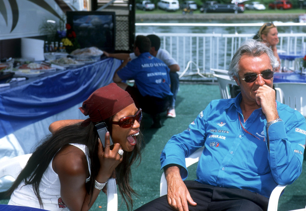 Mandatory Credit: Photo by CRISPIN THRUSTON/REX Shutterstock (379508aj) NAOMI CAMPBELL ON HER MOBILE PHONE WITH FLAVIO BRIATORE AT CANADIAN GRAND PRIX - 2001 VARIOUS MOTOR RACING