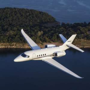 Aerial photography of the Textron Cessna Latitude business jet flying over Keystone Lake, west of Tulsa, OK.  Mid-Continent Airport (ICT) Wichita KS USA